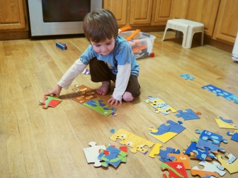 Puzzles are his true love right now. A new big floor puzzle is always a time for fun and excitement, even after his toddler sister managed to pour a bottle of Vanilla extract all over it.