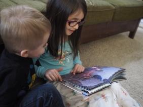 Big sisters make great bedtime story readers.