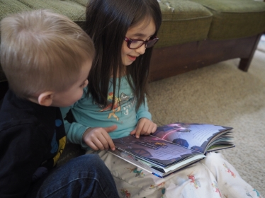 Big sisters make great bedtime story readers.