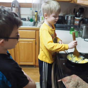 A asked N to teach him how to make scrambled eggs. They both took the impromptu lesson very seriously, and the eggs turned out nice,
