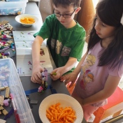 They decided to rebuild one of her old sets together, and required a snack of Cheetos to sustain them as they worked.