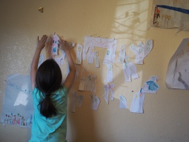 Branching out from her usual artistic expression - posters cover huge expanses of her wall - she decided to start a paper garden. This is just the initial morning's planting - it's become more elaborate since.