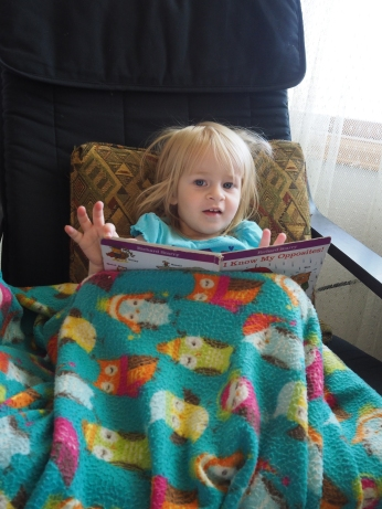 She loves books. A comfy chair, a pillow, a blanket and a book are all she needs to be content.