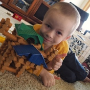A is usually more interested in building super villains with LEGOs, but today he decided to build some barns out of Lincoln Logs and had a whole lot of fun.