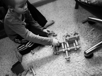 Not satisfied with regular buildings and log cabins, A has been using the Lincoln Logs in more creative ways recently. This is a work in progress - a quadruple catapult. It didn't work quite as well as he hoped, but maybe next time he'll solve his problems.