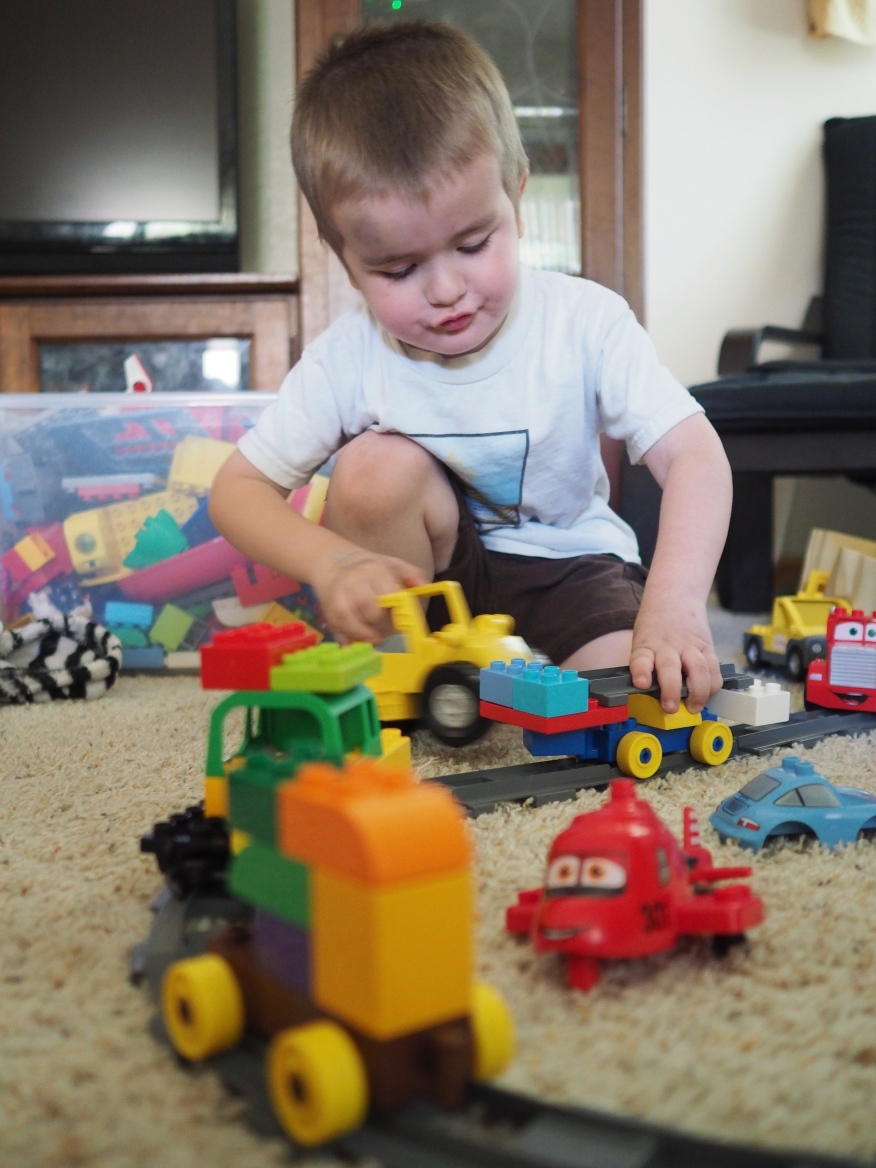 He really loves trains. Good Guy Trains, Villain Trains, Robot Mech Fighting Trains, you name it. Today he was building Police Trains.