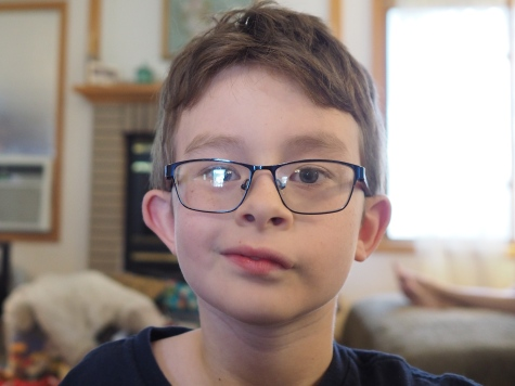 I love this picture. He looks akward and there are some wonky reflections on his glasses, but he's been practicing some trademark grins lately, and this seems to be one of his favorites.