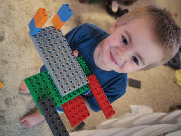 He liked building spaceships out of DUPLO blocks, and he's always very proud of his creations. As he should be!