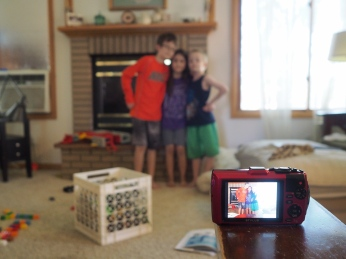 They've been experimenting with the timer on their camera to figure out how to take group selfies.