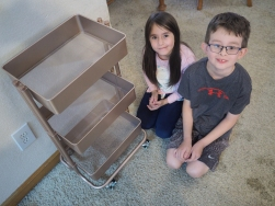 Mrs. Hatter had a cart that needed assembling. N, our family builder, set to work and put it together quite deftly and with no help to speak of. H did come along eventually and helped screw on a couple of wheels, but otherwise it was all his work.