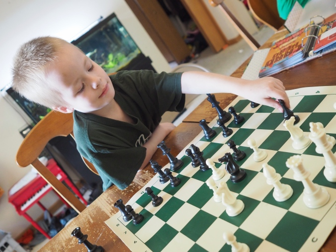 Chess club starts soon, so he's working to prepare for it, and doing very well!