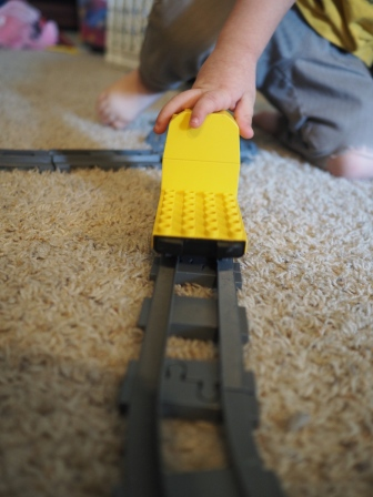 He loves trains almost as much as he loves sharks. This morning he was all about building DUPLO railroads.