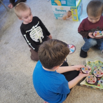 N is a great big brother. This morning he played Sneaky Snacky Squirrels with the little boys.