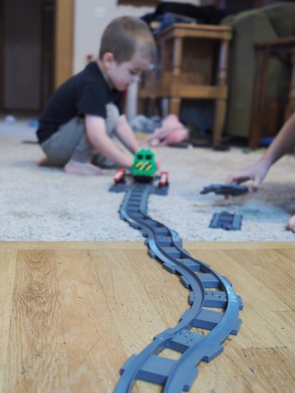The entire morning has been consumed by the construction and operation of a DUPLO railroad. H has been a great big sister, helping M to design amd build it all.
