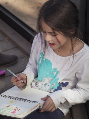 She's concentrating hard, trying to decide out how best to draw a tiger.