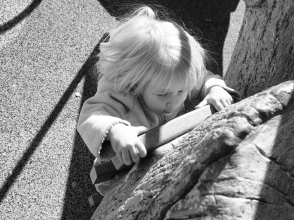 She wants to be as capable as her big siblings, particularly when it comes to climbing on playground equipment.