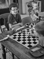 N has been teaching his little brother how to play chess. He's been developing his own methods to teach him the basic concepts of the game. He's very proud of his teaching skills.