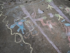 They've been working on ambitious chalk art. A jungle scene, complete with monkeys, a sloth, a moose, a beaver, and a cherry tree. Maybe they don't quite understand jungles yet, but that's okay.