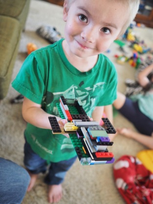 He's been moving beyond DUPLO bricks lately and has is very proud of his most recent LEGO build.