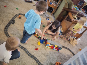 They all love trains, so some mornings they just need to build a railroad together.