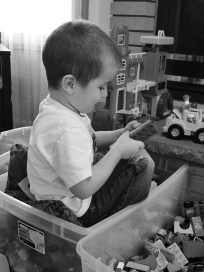 He thinks the best place to build with DUPLO bricks is to sit in the tub along with them. He's not wrong.
