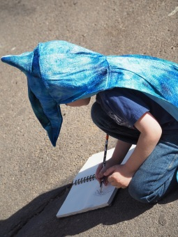 He loves sketching animals at the zoo. He also loves wearing his Pterodactyl cape.