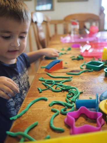 Today he made Play-Doh snakes. Lots of them, including babies, mommies and daddies. Then they joined together to make a Snake Monster. The kid has a fun imagination.