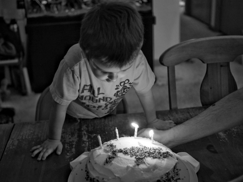 He didn't even wait for the cake to be set on the table before he was blowing out the candles. He really loved his birthday this year.