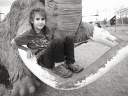Her favorite things about this park are the cool climbing features. Like the giant mammoth.